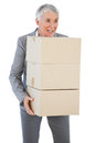 Happy businesswoman holding cardboard boxes on white background Royalty Free Stock Photo