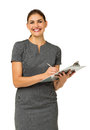 Happy businesswoman holding clipboard and pen portrait of mid adult against white background vertical shot Stock Photo