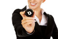 Happy businesswoman holding eight billiard ball. Royalty Free Stock Photo