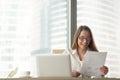 Happy businesswoman holding financial report, enjoying company s