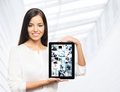 A happy businesswoman holding a tablet business women with the computer over the office background Stock Photo