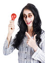 Happy businesswoman in horror makeup pointing at red light bulb scary idea concept Royalty Free Stock Image