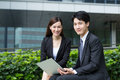 Happy businesswoman and man hold with laptop computer Royalty Free Stock Photo