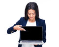 Happy businesswoman pointing on the blank laptop screen over white background Stock Photos