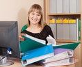 HAppy businesswoman reading  documents Royalty Free Stock Image