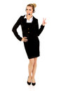 Happy businesswoman showing victory sign. Royalty Free Stock Photo