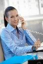 Happy businesswoman speaking on phone Royalty Free Stock Photo