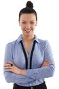 Happy businesswoman standing arms crossed young looking at camera Stock Photo
