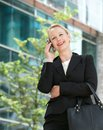 Happy businesswoman talking on cellphone outdoors portrait of a Royalty Free Stock Photography