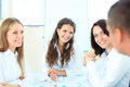 Happy businesswomen listening to young men explanations Royalty Free Stock Image