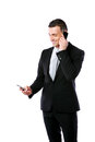 Happy busy businessman using two mobile phone over white background Royalty Free Stock Images