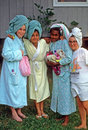 Happy campers four young girl friend wearing turban wrapped towels on their heads Royalty Free Stock Photography