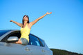 Happy car driver on roadtrip joyful woman summer blissful girl having fun travel Royalty Free Stock Images