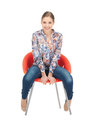 Happy and carefree teenage girl in chair Royalty Free Stock Images