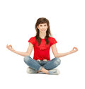 Happy and carefree teenage girl in lotus pose bright picture of Stock Photo