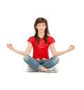 Happy and carefree teenage girl in lotus pose bright picture of Stock Photography