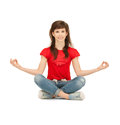 Happy and carefree teenage girl in lotus pose bright picture of Royalty Free Stock Photo
