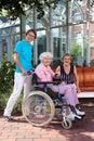 Happy Caregivers and Elderly Portrait. Royalty Free Stock Photo