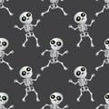 Happy cartoon skeleton seamless pattern on dark grey background Royalty Free Stock Photo