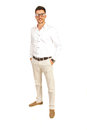 Happy casual man with eyeglasses executive standing hands to pockets pants isolated on white background Stock Images