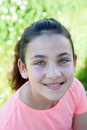 Happy casual preteen girl looking at camera Royalty Free Stock Photo