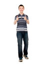 Happy casual young man holds his thumbs up isolated on white background Royalty Free Stock Photos