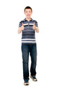 Happy casual young man holds his thumbs up isolated on white background Stock Photo