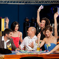 Happy caucasian friends playing blackjack in casin Stock Photography