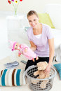 Happy caucasian woman putting toys into a basket Stock Images