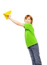 Happy caucasian years old boy green shirt holding yellow paper plane isolated white Stock Photo