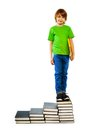 Boy standing on stairs of books Royalty Free Stock Photo