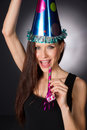 Happy celebration attractive adult woman noise maker party hat beautiful at waiting to make at midnight Royalty Free Stock Image