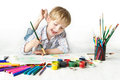 Happy cheerful child drawing with brush in album Royalty Free Stock Photo