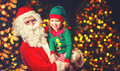 Happy cheerful laughing child elf helper and Santa Claus at Chri Royalty Free Stock Photo