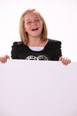 Happy Cheerful Preteen Girl Holding a Sign Royalty Free Stock Photo