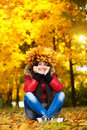 Happy cheerful woman in a wreath with autumn leafs Stock Photo