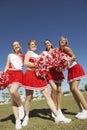Happy Cheerleaders On Field Royalty Free Stock Photography