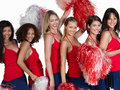 Happy cheerleaders posing Stock Image