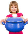 Happy chef girl stirring soup Stock Images