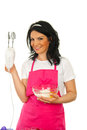 Happy chef woman showing mixer Stock Photo