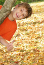 Happy child in autumn leaves Stock Images