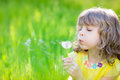 Happy child blowing dandelion flower outdoors Royalty Free Stock Photo