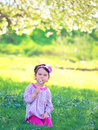 Happy child blowing dandelion outdoors in spring Royalty Free Stock Photo