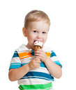 Happy child boy eating ice-cream isolated Royalty Free Stock Image
