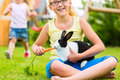 Happy Child With Bunny Pet At ...