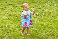 Happy child chasing soap bubbles Royalty Free Stock Photo