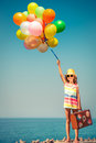 Happy child with colorful balloons Royalty Free Stock Photo