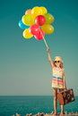 Happy child with colorful balloons on summer vacation Royalty Free Stock Photo