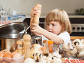 Happy child cooking soap little girl near kitchen table Royalty Free Stock Photography