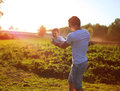 Happy child dad and son having fun holding on hands a sunset background Stock Images